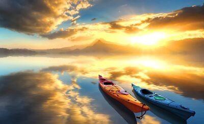 Două bărci de canoe pe un lac la răsărit